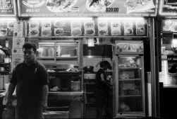 Taken at the enormous hawker centre in chinatown point, the lighting in this amazing haven of food was extremely challenging to work with. Dark shadows combined with bright signboards made this shot a clear examplar of the relatively narrow dynamic range of BW film.